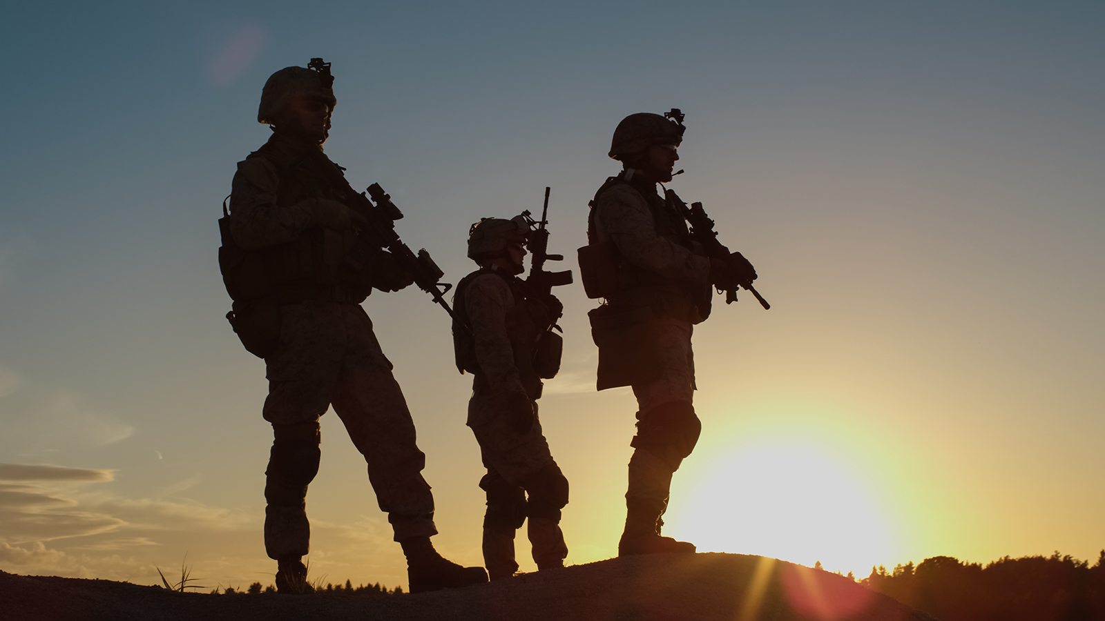 Soldiers standing on hilltop